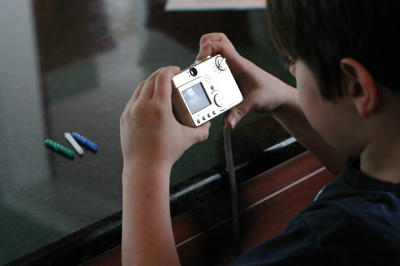 Child photographing candles