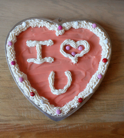 Heart shaped pie decorated with frosting for valentine's day