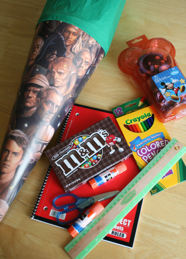 School supplies to fill inside a Schultüte: colored pencils, m&m's, scissors, crayongs, paper, glue stick, ruler