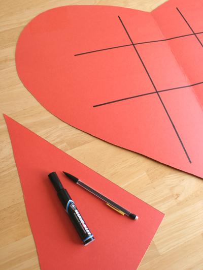 Drawing tic tac toe board on paper heart