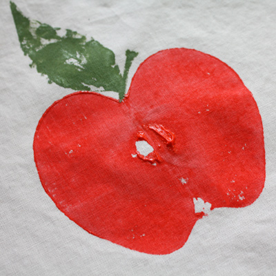 close up of an apple print on fabric