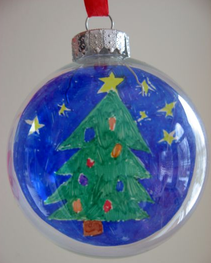 Children's artwork displayed inside of Christmas ornament