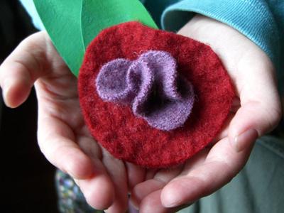 Felt flower in a child's hand