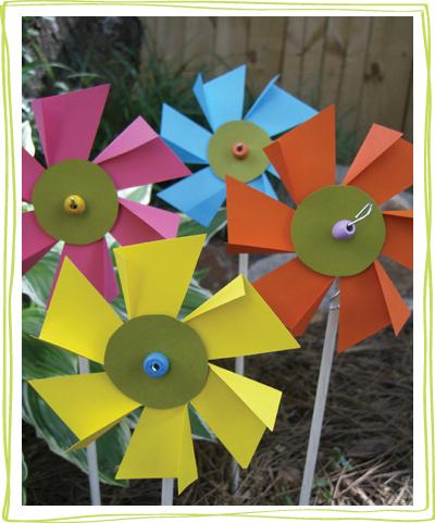 Paper flower pinwheels in a garden