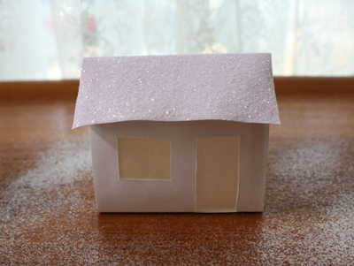 Paper glitter house on a table