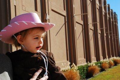 A child wearing a pink cowboy hat