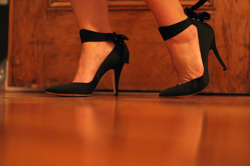 Shot of feet with black satin shoes on