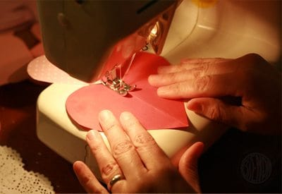 sewing a paper heart