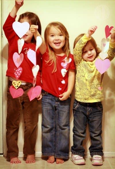 dangling paper heart garland made by children