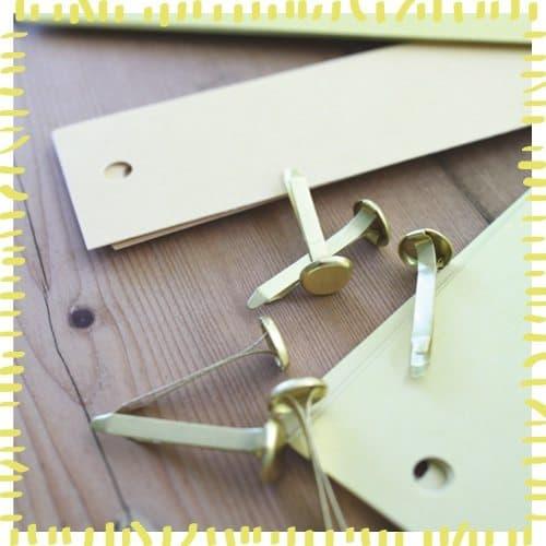 Paper fasteners for sun globe craft
