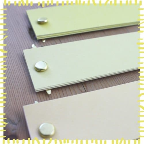 paper fasteners inserted into paper holes