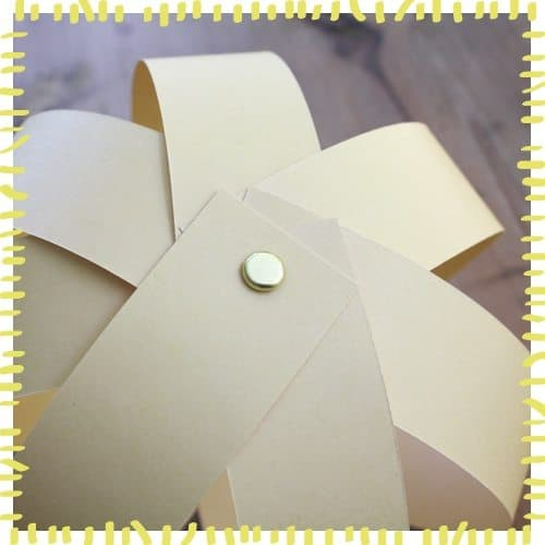 Shaping paper strips for sun globe craft