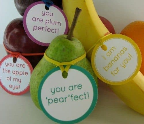 Encouraging messages for kids tied to fruit with rubber bands