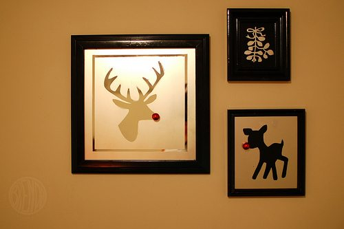 reindeer photos hanging in frames on a wall