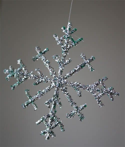 Glitter snowflake made from plastic berry basket
