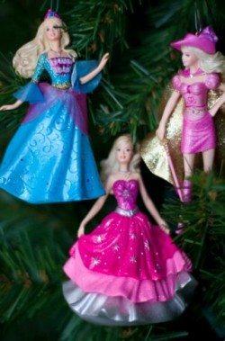 Three princess Christmas ornaments hanging in tree