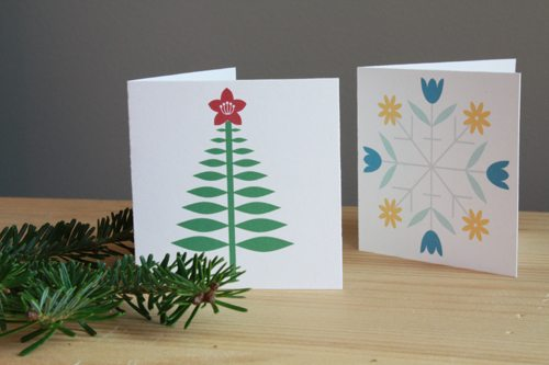 printable Christmas cards on table