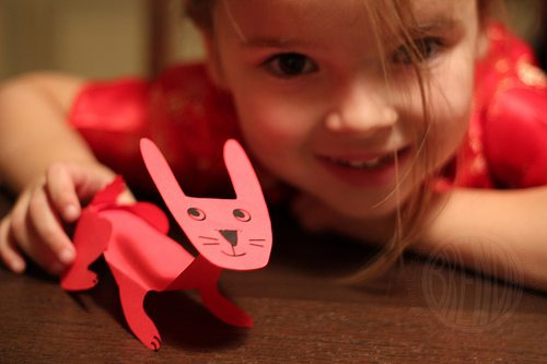 child showing off her rabbit paper craft
