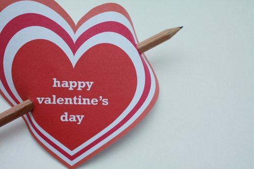 Heart shaped Valentine's Day card with pencil through it