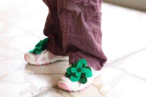 Four-leaf clover felt accessory on shoes