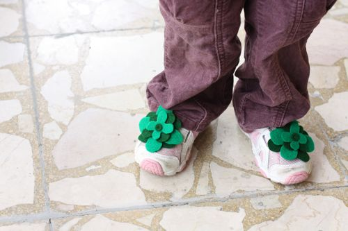 felt four-leaf clover accessories worn on a pair of shoes