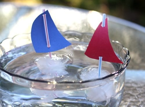 ice cube boats floating in a bowl of water