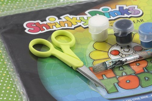 supplies for tiny vinyl craft (shrinky dinks, paint, scissors, paint brush)