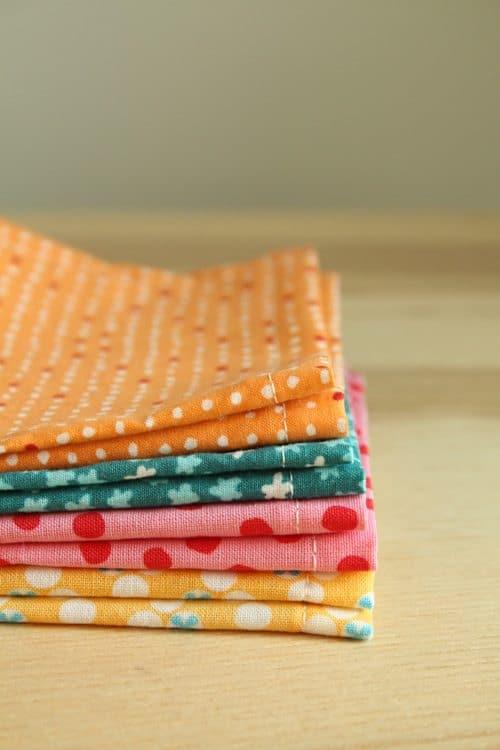 a stack of fabric napkins in a variety of patterns