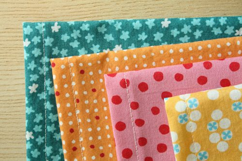 4 different patterned fabric napkins on a table