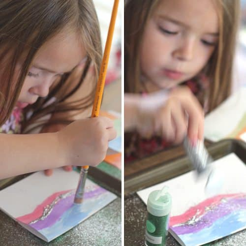 Child painting and adding glitter
