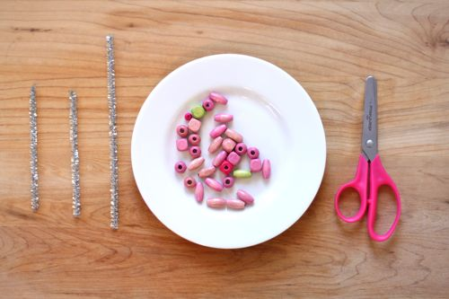 beads on a plate with pipe cleaner and scissors for Beaded Snowflake Ornament