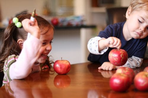 Kids embellishing apples for Holiday Decor