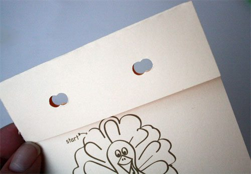 holes punched in Thanksgiving turkey trivia card