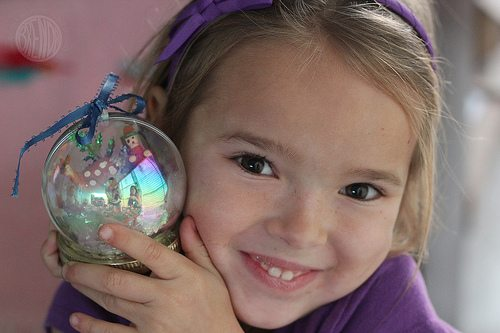 Child holding waterless snow globe