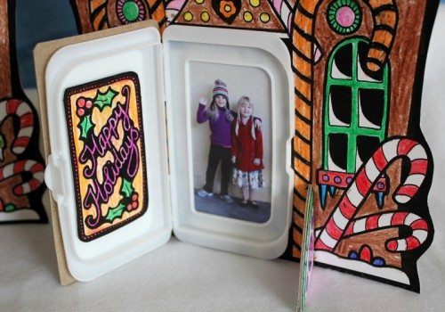 Gingerbread house holiday card displaying a family photo