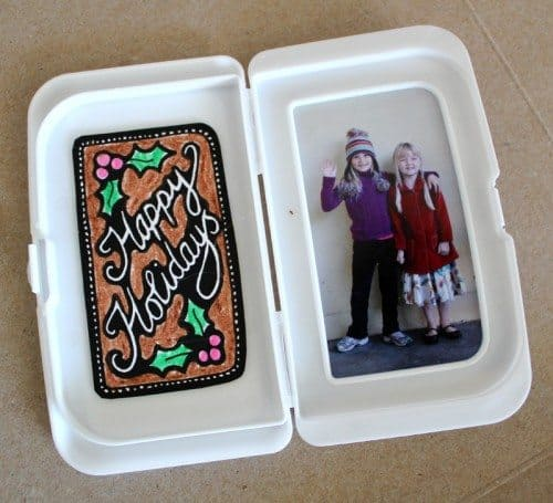 Gingerbread house holiday card with child photo inside
