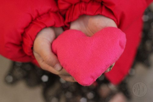 heart shaped felt hand warmer in a child's hands