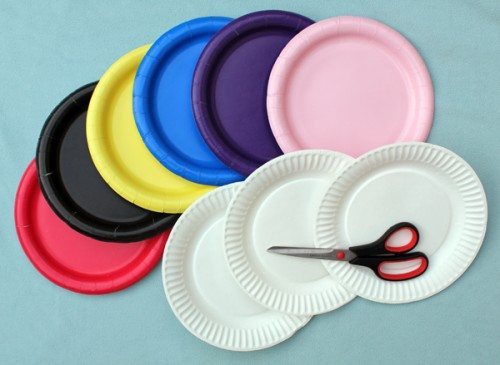 assorted colored paper plates and a pair of scissors