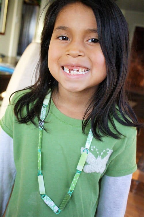 Smiling girl wearing a St.Patrick's Day necklace