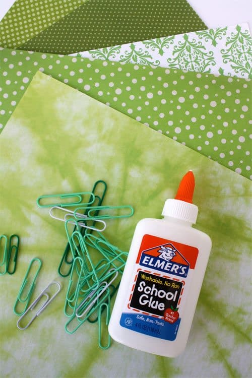 supplies for St. Patrick's Day craft (paper clips, glue, green paper)