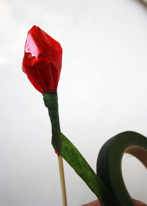 Wrapping chocolate roses with floral tape