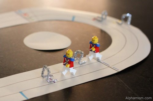 Lego figures walking on Olympic track and field (craft)