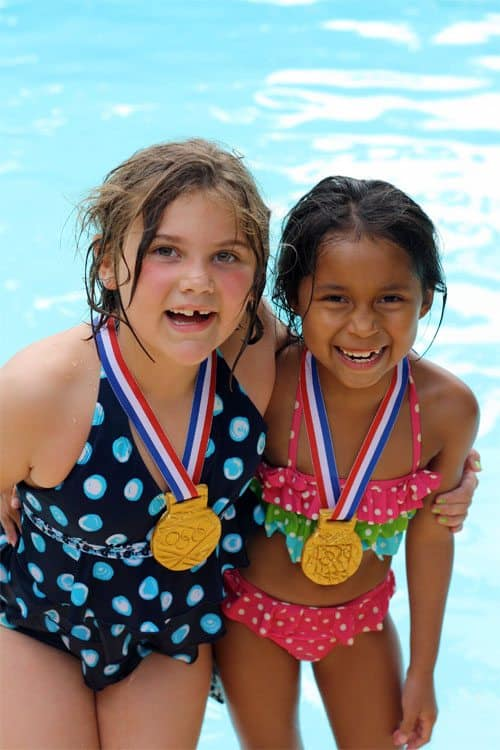 Children wearing Olympic Gold Medal crafts