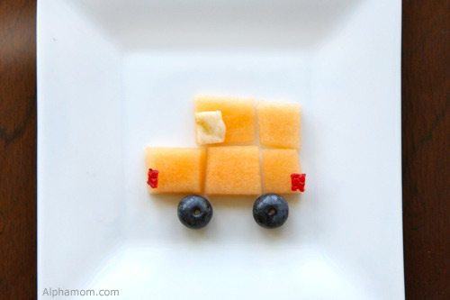 little truck made out of fruit