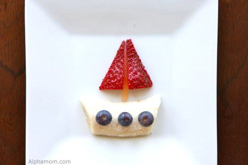 sail boat made out of fruit