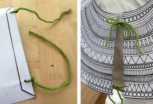 adding green string to paper mummy collar for mummy costume
