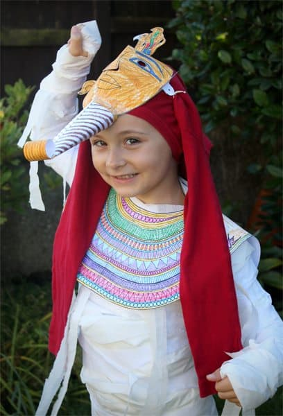 a young child wearing a DIY Pharaoh's Kids' Mummy Costume
