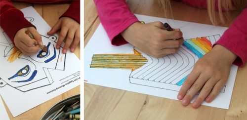 close up of children's hands coloring a mummy printable