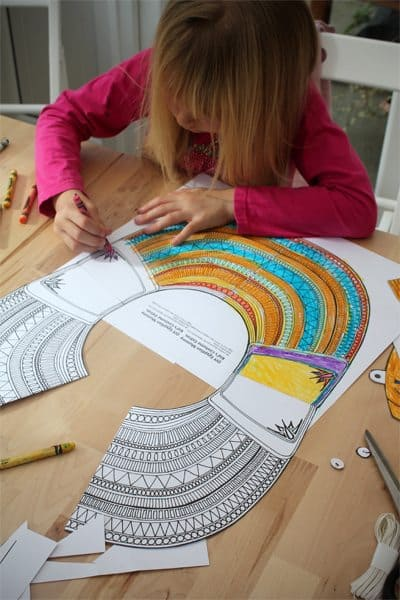 a girl coloring mummy collar coloring sheet