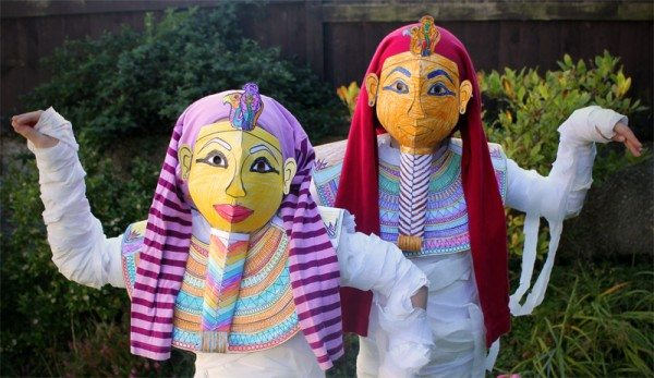 Egyptian mummy mask costumes being worn by two children